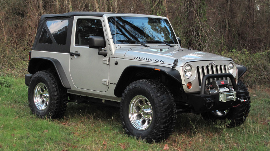 rubicon with no lift bushwacker flares and 35 inch tires. Black Bedroom Furniture Sets. Home Design Ideas